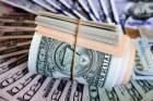 Depois de atingir maior valor em seis meses, dólar cai a R$ 5,56